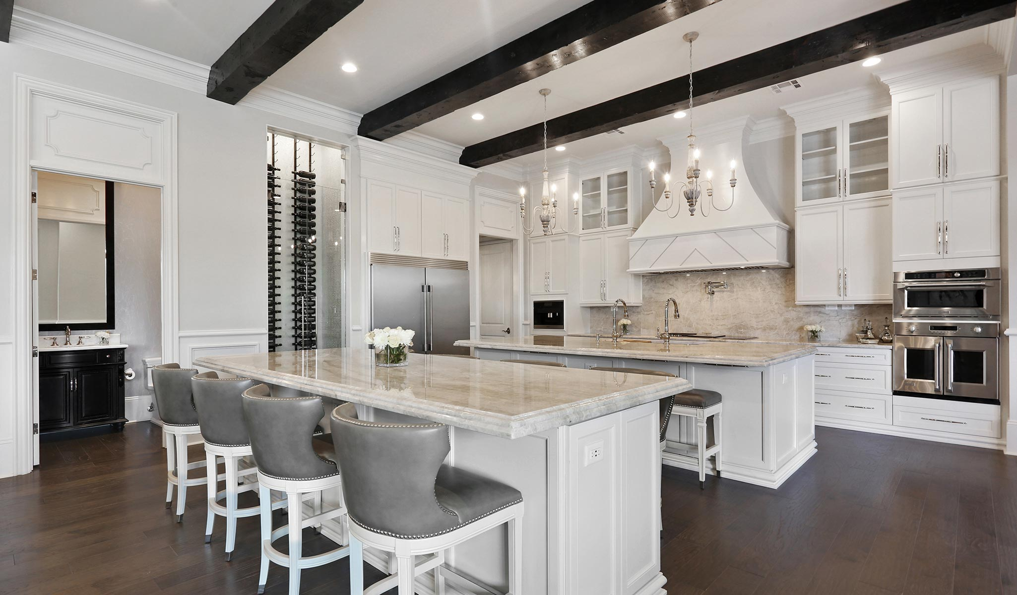 kitchen with bar seating & a wine cooler